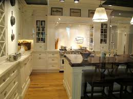 white kitchen with tiles solid wood cabinet doors l shaped islands