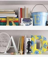 bookshelf organization ideas 22 ways to arrange your shelves real simple