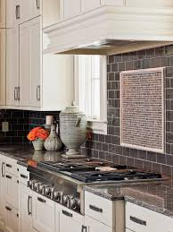 dark kitchen cabinets with light granite countertops limestone