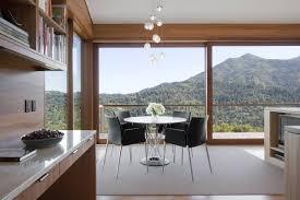 sleek contemporary kitchen near breakfast nook with circular table