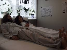 what preposition is correct sleep on the bed or sleep in the wikipedia image of john and yoko