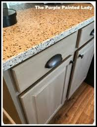 how to whitewash painted cabinets kitchen cabinet the purple painted