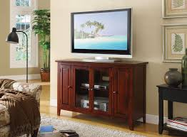 tv stand glass doors brown wooden tv stand with glass doors storage on the middle