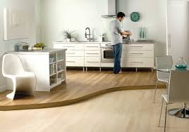 Laminate Kitchen Floor Laminate Flooring Kitchen Delivered By Inspire Flooring Aberdeen Where A Man Is Preparing A Cup Of Coffee Jpg