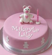 cute round pink first birthday cake with teddy bear topper jpg