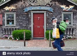 sailor walking by an antique shop nantucket town nantucket cape