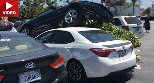 Black Mustang Crash Ford Mustang Crashes In Parking Lot And Lands On Top Of A Corolla