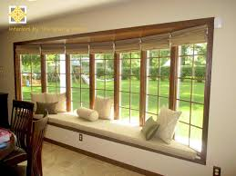 geometric bay window roman shades patterned roman blinds in a bay