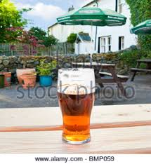 Beer Garden Tables by Traditional Pint Of Bitter Beer On Country Pub Beer Garden Table