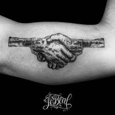 surrealist handshake duel tattoo on the left inner arm weapon