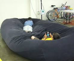 fancy bean bag bed with blanket and pillows