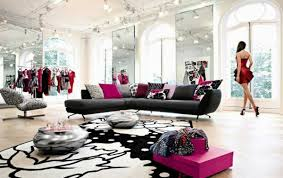 black sofa design and white wall design in modern living room