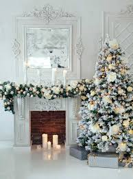 white tree decorations and fireplace backdrop
