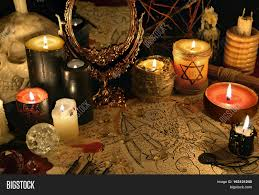 halloween text symbols mystic still life with demon manuscript mirror and black candles