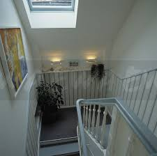 Painted Banisters Image Looking Down Staircase With Pale Blue Painted Banisters And