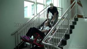 portable electric stair climbing chair for transferring disabled