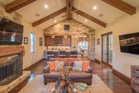 living room mediterranean living room design with relaxed mood mediterranean open plan living room with exposed beam vaulted ceiling