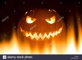 spooky carved halloween pumpkin in burning hell fire flames