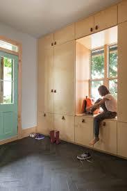 interior white window seat with storage shoe storage seat front