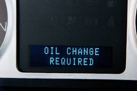 how to reset the oil change required on a ford vehicle it still