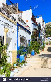 typical street with whitewashed mediterranean houses alicante old