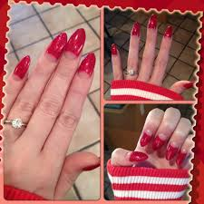 stiletto half moon nails by ruby i love the sparkly red it makes