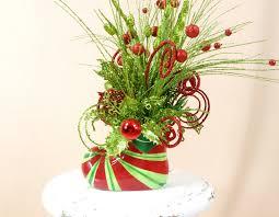 red and green arrangement santa boot centerpiece christmas
