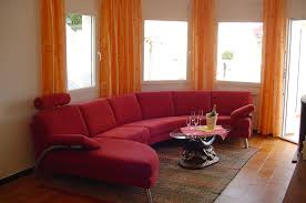 Wohnzimmer Orange Wohnzimmer Einrichtungsideen In Schwarz Orange Möbelhaus Dekoration