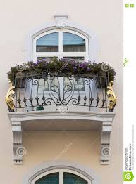 vintage house balcony with golden ornament stock photo image