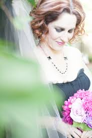 an elegant blush and black halloween wedding styled shoot