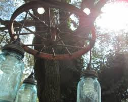 Mason Jar Wagon Wheel Chandelier 52 Best Wagon Wheel Images On Pinterest Garden Gardening And