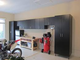 Woodworking Plans Garage Cabinets by Custom Garage Cabinets Storage Solutions In St Louis