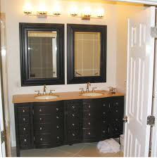black wooden bathroom double vanity with brown wooden top and