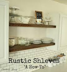 rustic open shelves in between cupboards creatively living