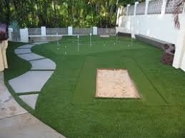 Backyard Putting Green Installation by Backyard Synthetic Turf Putting Green With Sand Trap And Chipping