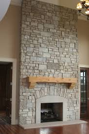 wall fireplace with tv wood framed mirror on cream wall square