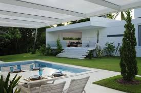 fascinating modern outdoor white blue swimming pool design feats white contemporary house in brazil with swimming pool dining table in pool pool