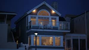night hold two story house duplex apartment white wood porch