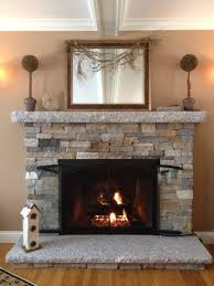 stacked stone fireplace but with dark cherry wood mantle diy