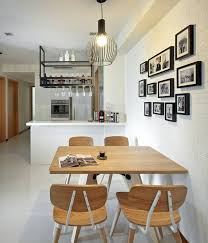 mirrors are used extensively to make the small condominium space