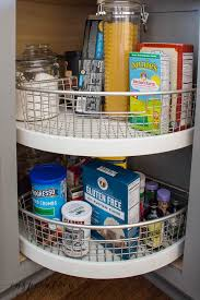 how to organize corner kitchen cabinets i ve turned a new corner organizing the corner lazy susan