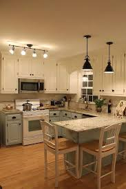 best light color for kitchen best small kitchen lighting ideas with two tone cabinets 9463