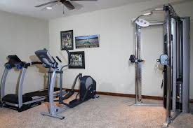 Small Treadmills For Small Spaces - interior small space home gym ideas with red painted wall and