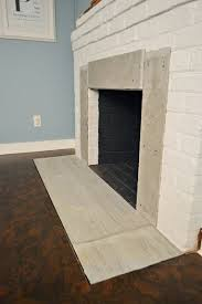 How To Cover Brick Fireplace by Fireplace Makeover Tiling The Mantel With Marble Herringbone