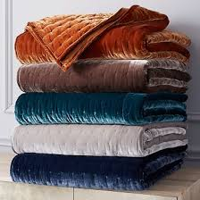 west elm coverlet quilt in light gray with euro shams in copper for accents the