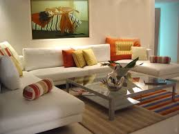 pretty small interior living room with yelow and orange accents