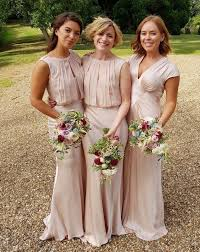 ghost wedding dress burr looks beautiful as a bridesmaid in a blush pink