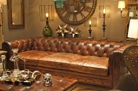 classic brown tufted leather deep seat sectional in gothic room