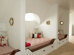 bedroom white walls attic room under bed storage beige carpet