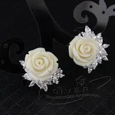 earrings hong kong exclusive proud snow silver carved coral bell earrings stud